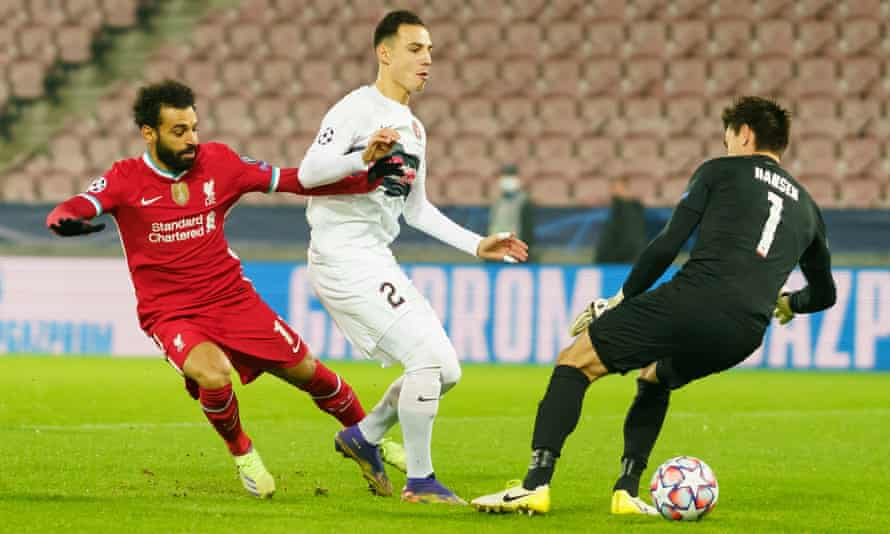 Mohamed Salah nutmegs Midtjylland goalkeeper Jesper Hansen to give Liverpool the lead after 55 seconds of the match.