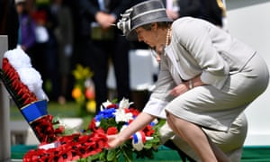 Theresa May laying a wreath during the Royal British Legion Service of Remembrance at the Commonwealth War Graves Cemetery at Bayeux, France, today.
