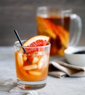 Kombucha tea with a slice of grapefruit and ices. Kombucha mushroom tea is a natural fermented drink originally from China.