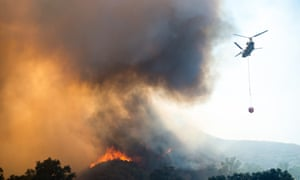 A helicopter drops water on a fire in Lake county north of San Francisco.