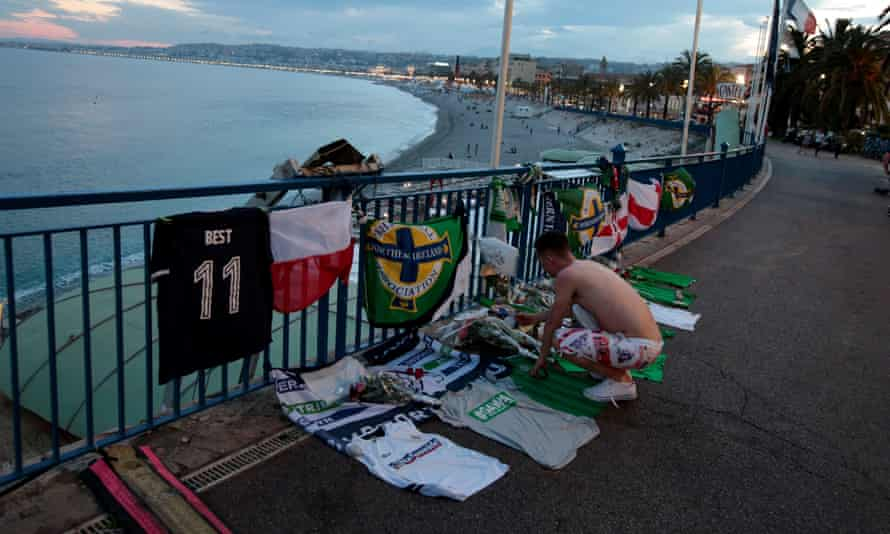 A man pays tribute to Darrne Rodgers, the Northern Ireland fan who died in an accident in Nice.