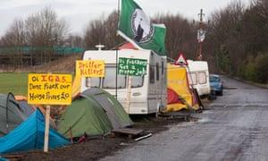 tents, a caravan and placards at Barton Moss anti-fracking camp
