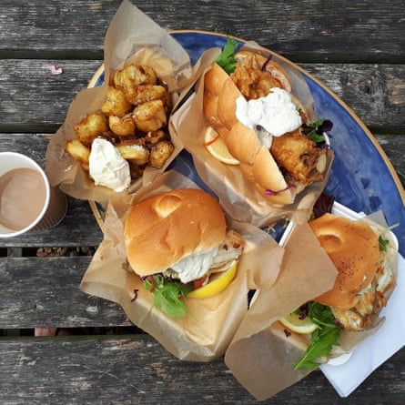 Food photo of seafood rolls and potato wedges from Dungeness Snack Shack.