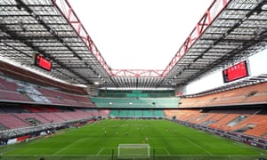 Milan play Genoa in an empty stadium in Serie A.
