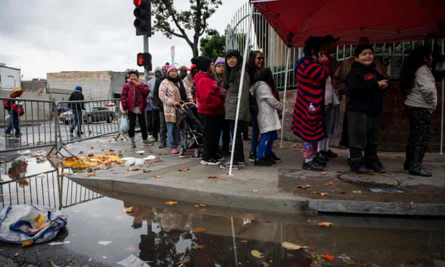 People line up outside the Los Angeles Mission homeless shelter for a holiday meal.