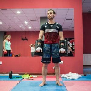 Jashar Jashari, 22, works as a boxing coach at the Kickbox Rigoro Gym in Pristina