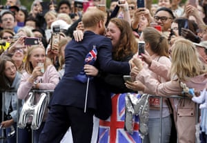 Britain's Prince Harry hugs a member of the public as he arrives at the Royal Botanic Gardens in Melbourne, Australia, Thursday, Oct. 18, 2018. Prince Harry and his wife Meghan are on day three of their 16-day tour of Australia and the South Pacific. (Phil Noble/Pool Photo via AP)