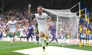 Liam Cooper celebrates scoring the third goal for Leeds United in the win over Stoke City at Elland Road.