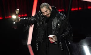 Post Malone accepts the award for top male artist