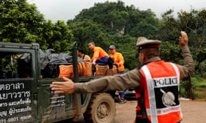 Rescue workers near the Tham Luang cave complex, where 12 schoolboys and their soccer coach are trapped inside a flooded cave.