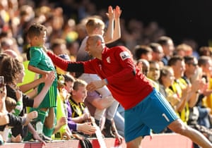 Watford goalkeeper Heurelho Gomes talks to a young fan after losing 4-1 to West Ham at Vicarage Road.