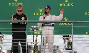 Lewis Hamilton interviewed by Elton John after winning the F1 world title.