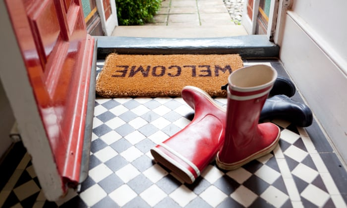 Wellington boots near a 'welcome' doormat