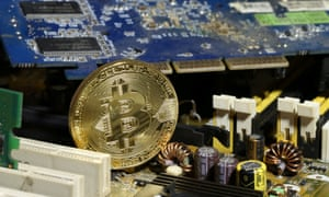 a bitcoin on a motherboard