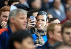 A West Ham fan is seen in a Carlos Tevez mask prior to the 1-1 draw between West Ham and Sheffield United at London Stadium.