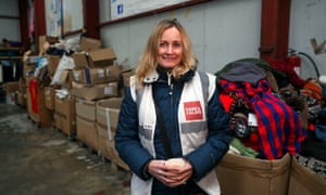 Clare Moseley, founder of Care4Calais in their warehouse near Calais, France.