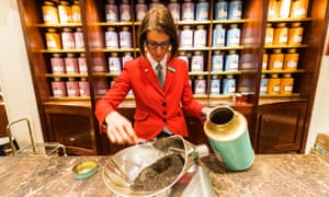 A sales assistant weighing tea at the Piccadilly flagship shop.