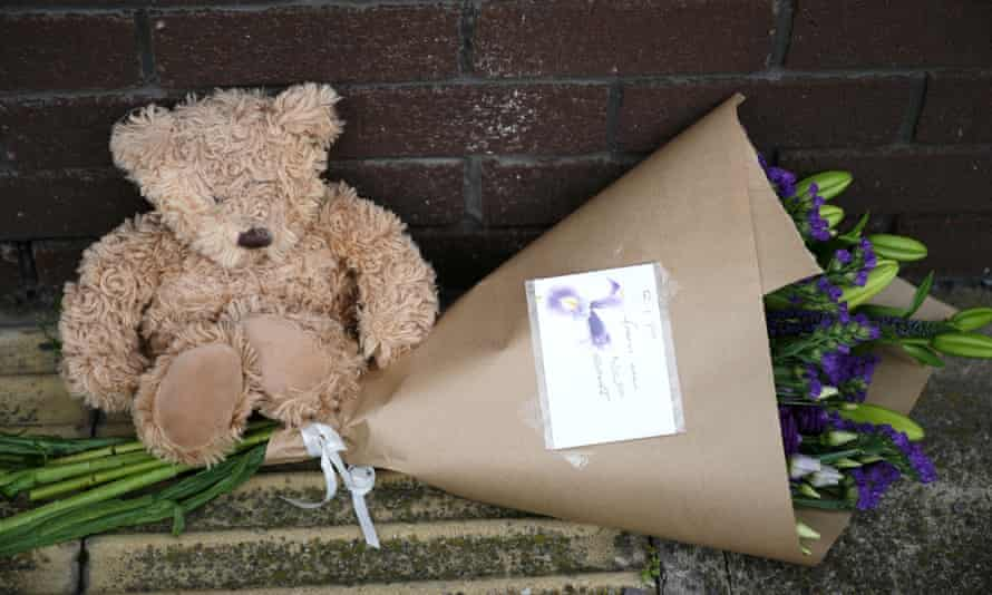 A toy bear and flowers left outside the OYO Metropolitan Hotel in Sheffield where a five-year-old Afghan boy fell to his death.