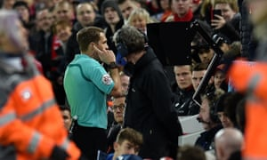 Craig Pawson consults the VAR system during January's FA Cup fourth round match between Liverpool and West Bromwich Albion at Anfield.