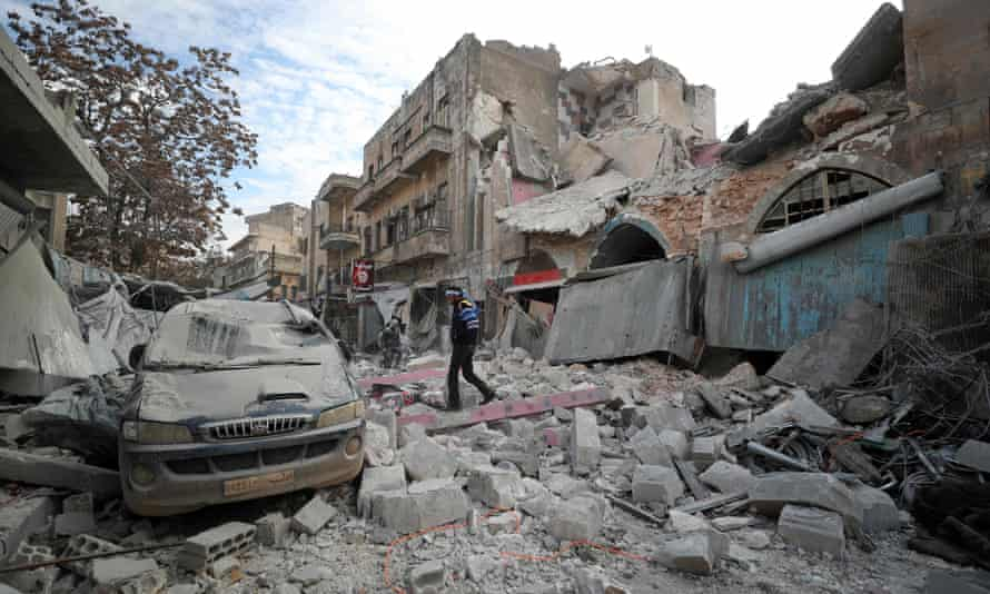 A Syrian walks among the rubble of a building after a regime airstrike in Syria's last major opposition bastion of Idlib.