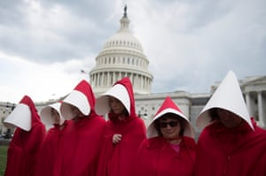 Supporters of Planned Parenthood dressed as characters from The Handmaid's Tale, rally outside the US Capitol in Washington DC in June.