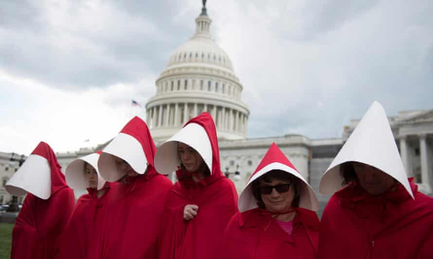 Protesters wear costumes inspired by The Handmaid's Tale at a rally in Washington DC in June 2017.