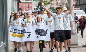 Activsts walk during the 50 Miles More march in Worcester, Massachusetts, on 23 August.