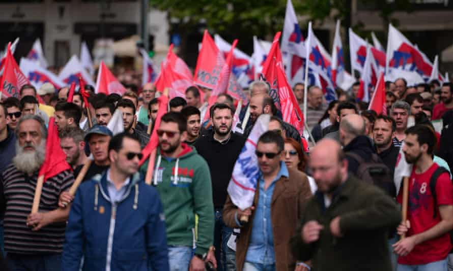 Protesters march towards the Greek parliament in Athens