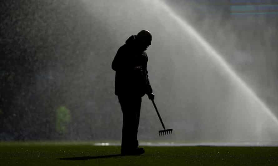 A member of staff doing maintenance work at Goodison Park.