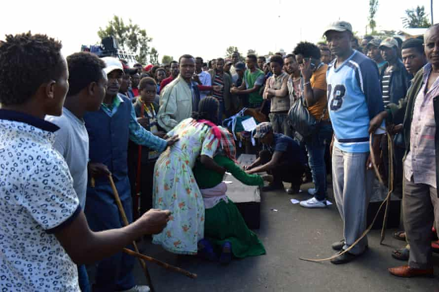 Protesters surround a makeshift coffin in the town of Wolenkomi in Ethiopia's Oromia region