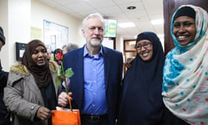 The Labour leader, Jeremy Corbyn, poses with women members of Finsbury Park mosque during its open day.