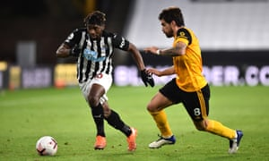 Newcastle's Allan Saint-Maximin under challenge from Rúben Neves.