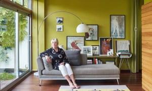 Niki fforde sitting on the sofa in her Modernist living room.