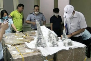 Customs officials with smuggled rhino horn pieces at Noi Bai international airport in Hanoi, Vietnam