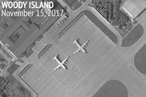 A satellite image of Woody Island in the Paracel island chain showing two Chinese Y-8 military transport aircraft.