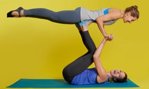 Zoe Williams practising AcroYoga with a partner