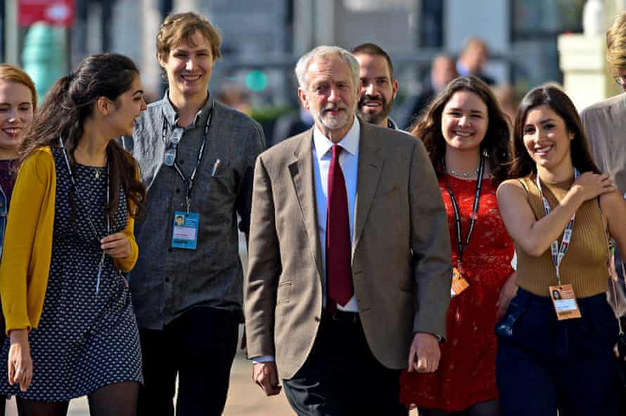 Jeremy Corbyn is flanked by supporters as he arrives to deliver his key note speech at Labour's autumn conference in Brighton