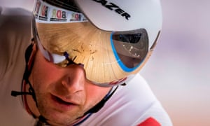 The track is reflected in the visor of Great Britain's Jason Kenny during the men's sprint