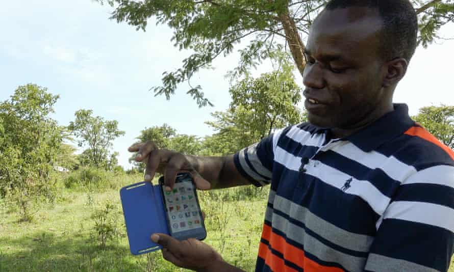 Wambura Kisika, a legal officer at the Mugumu safe house, demonstrates the technology