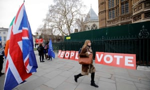 """FILES-BRITAIN-EU-BREXIT-POLITICS-PARLIAMNET(FILES) In this file photo taken on January 21, 2019 A pedestrian walks pas a placard reading """"People's Vote"""" as Brexit activits demonstrate outside of the Houses of Parliament in central London, whilst Britain's Prime Minister Theresa May makes a statement to the House of Commons on changes to her Brexit withdrawal agreement. - After British MPs rejected Prime Minister Theresa May's Brexit deal, they will on Tuesday vote on what they want her to do next. Unless it seeks a delay, Britain is scheduled to leave the European Union on March 29, deal or no deal. (Photo by Tolga AKMEN / AFP)TOLGA AKMEN/AFP/Getty Images"""
