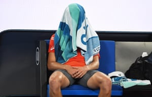 Alex de Minaur gets away from it all during a break in the match.