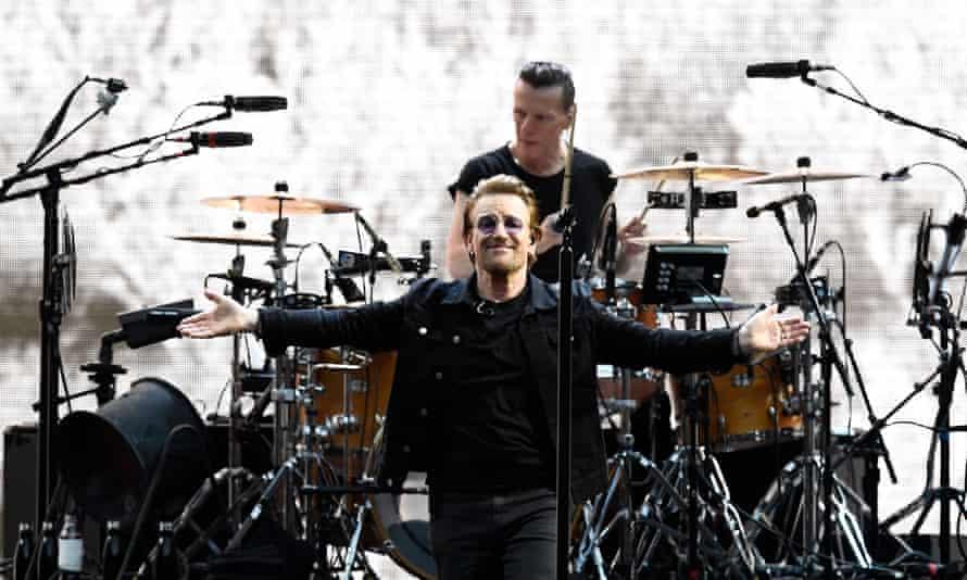 Risk takers ... Bono of U2 with Larry Mullen Jr at Twickenham Stadium on Saturday.