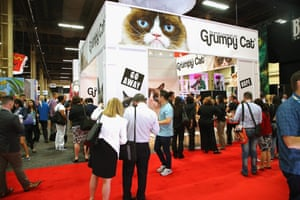 Attendees line up to get their photo taken with Grumpy Cat during the Licensing Expo at the Mandalay Bay Convention Center in Las Vegas in June 2016