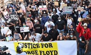 Thousands of protesters march with Terence Floyd, George Floyd's brother, over the Brooklyn Bridge on Thursday.