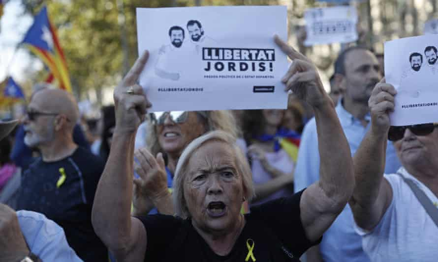 A protester holds a sign reading 'Freedom for the two Jordis' during a march in Barcelona on Saturday after the arrest of Catalan separatist leaders Jordi Sànchez and Jordi Cuixart.