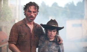 Lincoln as Rick Grimes with Chandler Riggs as Carl Grimes in The Walking Dead.