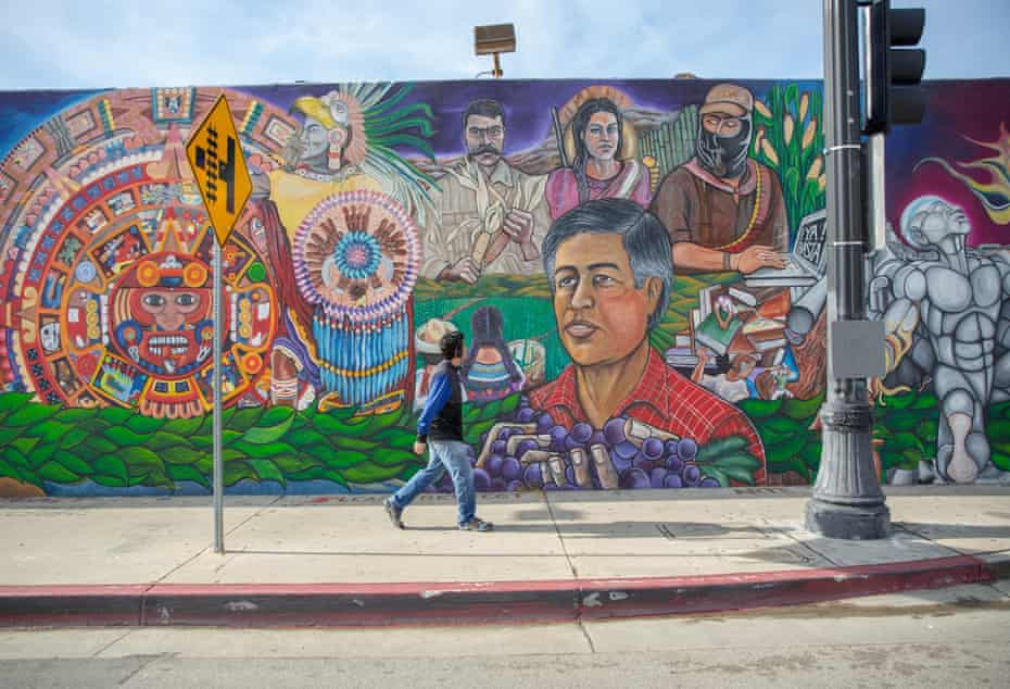 Artist John 'Zender' Estrada painted the mural, Tenochtitlan – the Wall That Talks, that runs along North Avenue 61 in Los Angeles with nine other artists.