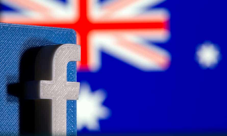 A 3D printed Facebook logo is seen in front of displayed Australian flag, photo taken February 18, 2021.