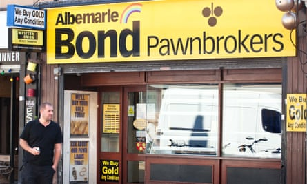 A member of Albemarle & Bond staff outside the pawnbroker's Oxford HQ