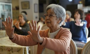 Residents do exercises at Silver Villa Koyama, a home for older people in Tokyo.